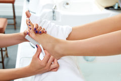 Pedicure dead skin remover feet care woman Stock Photos