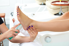 Pedicure dead skin remover feet care woman Stock Photography
