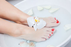 Pedicure foot treatment with water Royalty Free Stock Photos