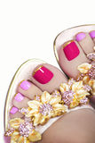 Pedicure with Golden flowers. stock images