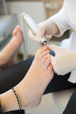 Pedicure grinding toe nails Stock Images
