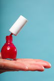 Pedicure manicure red nail polish on female palm Stock Photo