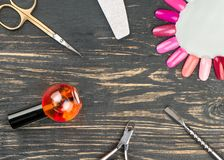 Manicure tool in table. Pedicure and manicure tools on wooden background, top view Royalty Free Stock Photo