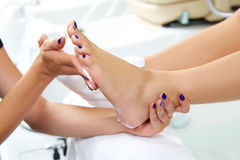 Pedicure moisturizing cram after foot rasp Stock Photography