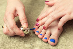 Pedicure with nail polish Stock Image