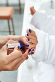 Pedicure nails polish blue in nail salon Stock Images
