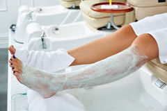 Pedicure nourishing mask legs cling film wrap Royalty Free Stock Photography