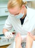 Pedicure procedure Stock Images