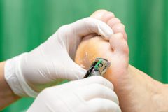 Pedicure  procedure in the beauty salon.  emover calluses on the Stock Images