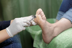 Pedicure  procedure in the beauty salon.  emover calluses on the Royalty Free Stock Image