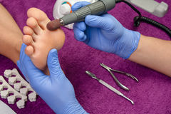 Pedicure. Process pedicure close-up, polishing feet, unrecognizable people Royalty Free Stock Photo
