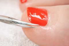 Pedicure process macro closeup Royalty Free Stock Image