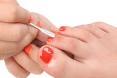 Pedicure process macro closeup Royalty Free Stock Photo