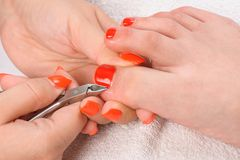 Pedicure process macro closeup Royalty Free Stock Photography