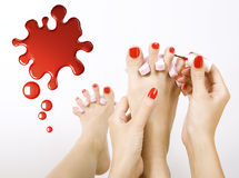 Pedicure process. Red manicure and pedicure Stock Photos