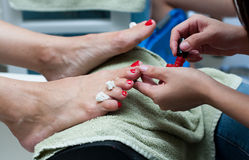 Pedicure in red nail polish Royalty Free Stock Photography