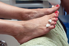 Pedicure in red nail polish Stock Image