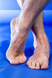 Pedicure Requested. A picture of a man's feet with toenails that could use a good pedicure Stock Photos