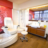 Pedicure room. A modern pedicure room with a comfortable armchair and specialized equipment Royalty Free Stock Image