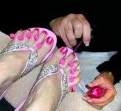 Pedicure - rosafarbene Zehennägel Stockbilder