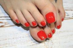 pedicure rosso alla moda fotografie stock