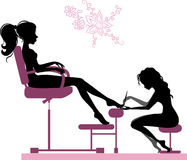 Pedicure. Silhouette of girl making pedicure in beauty salon Royalty Free Stock Photo
