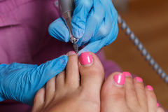 Pedicure Spa salon. Removing the old gel nail polish. Royalty Free Stock Photo