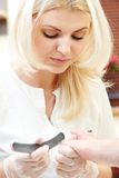 Pedicure specialist in beauty salon Stock Images