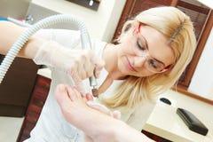 Pedicure specialist in beauty salon Stock Image