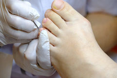 Pedicure specialist works with the patient Royalty Free Stock Images