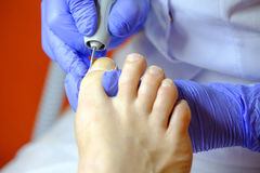 Pedicure specialist works with the patient Stock Photos