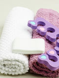 Pedicure, toe separators on towels Stock Photo