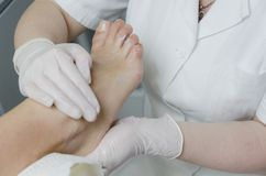 Pedicure treatment. Close up view at the pedicure treatment Royalty Free Stock Photography