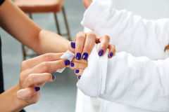 Pedicure treatment to woman feet in nails salon Royalty Free Stock Photo