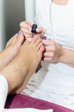Pedicurist at Beauty Salon Stock Photography