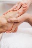 Pedicurist massaging a customers feet Royalty Free Stock Photo
