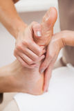 Pedicurist massaging customers foot Royalty Free Stock Photography