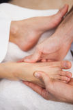Pedicurist massaging a customers foot Royalty Free Stock Photo