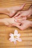 Pedicurist massaging a customers foot Royalty Free Stock Photography