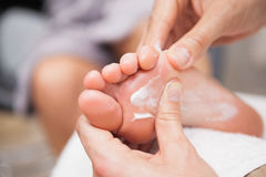 Pedicurist massaging a customers foot Royalty Free Stock Image