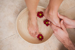 Pedicurist washing a customers feet Stock Photos
