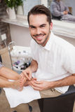 Pedicurist working on customers foot Royalty Free Stock Photo