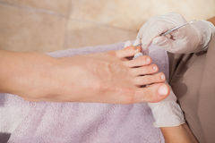 Pedicurist working on customers nails Royalty Free Stock Images