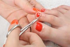 Pedikyrprocess, nagelbandklipp Arkivfoto