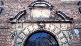 Pediment. Broken segmental pediment above entrance. Example of renaissance architecture element in the Netherlands Stock Photo