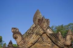 Pediment in Banteay Srei Temple. Pediment detail in Banteay Srei Temple Royalty Free Stock Photo