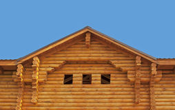 Pediment of new log cottage. Pediment of new wooden cottage against the blue sky Stock Photography