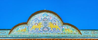 The pediment of Qavam House, Shiraz, Iran. SHIRAZ, IRAN - OCTOBER 12, 2017: The pediment of Qavam House in Naranjestan complex is decorated with tiled patterns stock photos