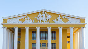 The pediment of the theater with the barrels. On the background of the blue sky Royalty Free Stock Photography