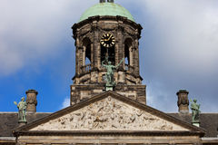 Pediment and Tower of the Royal Palace in Amsterdam Stock Images